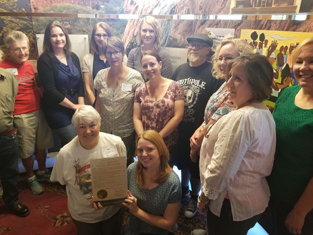 Water/Ways Install team poses with the Water/Ways Week Proclamation from Governor Doug Ducey